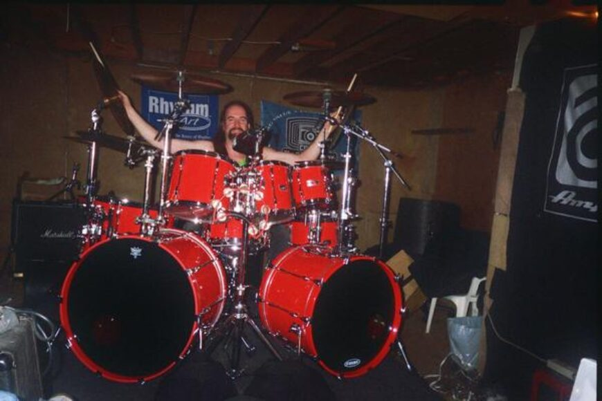 Kenny Burns with some of his trademark Hot Red Kit.He has 20 tom toms, 4 bass drums and 4 snare drums in that color for various gigs.